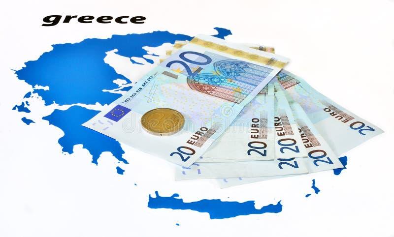 European help of Greece (euro zone crisis). Greece crisis (euro banknotes and coin on map of Greece stock photos
