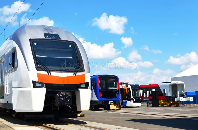 European high-speed passenger train and modern subway rolling stock and tramway on an open railway area of the rail car assembly royalty free stock photography