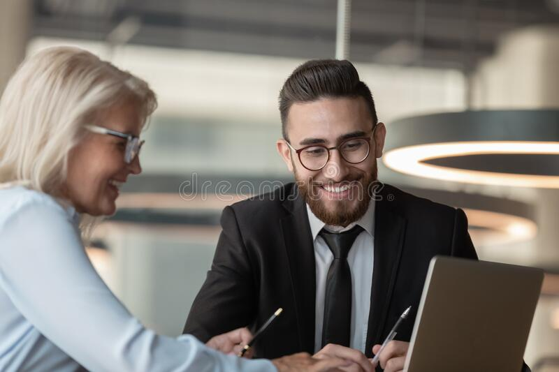 European manager consulting arabian client using computer process provide information royalty free stock photography