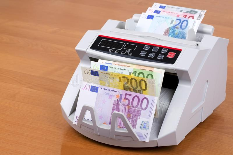 European money in a counting machine stock photos
