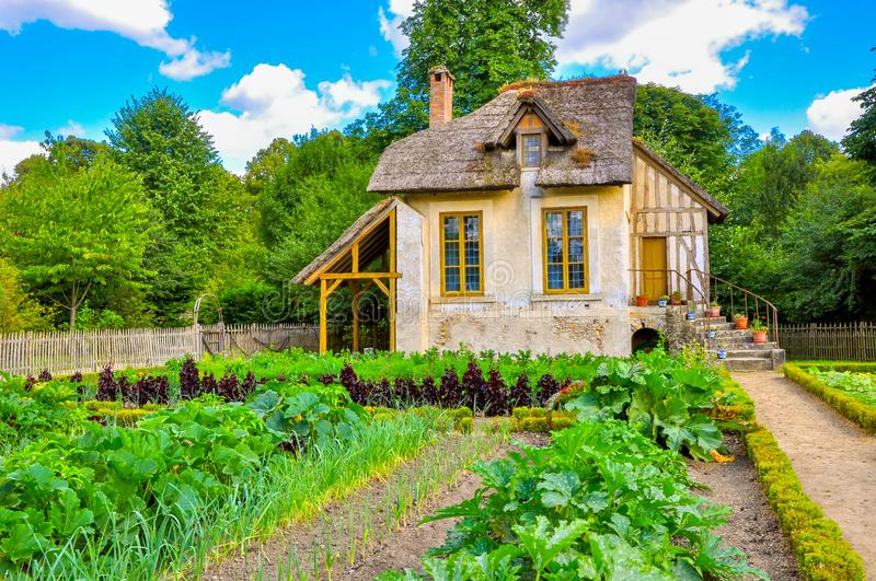 European rustic landscape. An old French house with a large garden stock photography