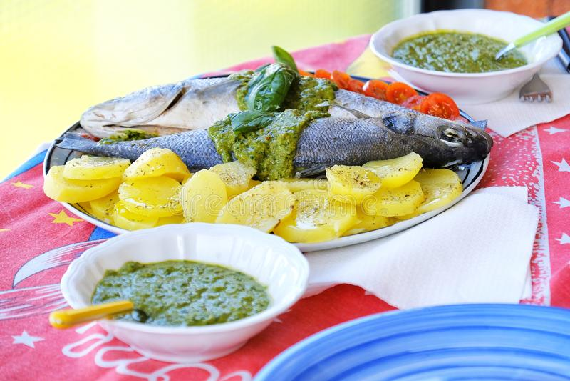 European sea bass branzino steaming potatoes tomatoes basil sauce recipe stock image