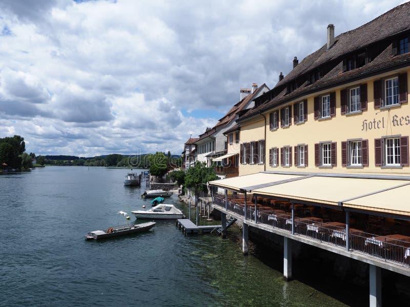 European STEIN am RHEIN town in SWITZERLAND, yellow building on Rhine River landscape in swiss canton of Schaffhausen stock images