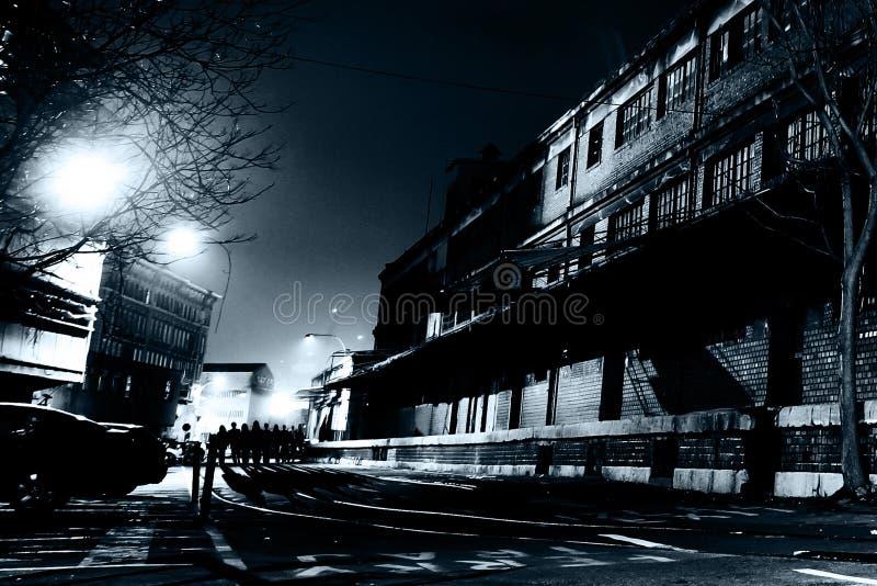 Zombies at Dark Street at Night stock photo