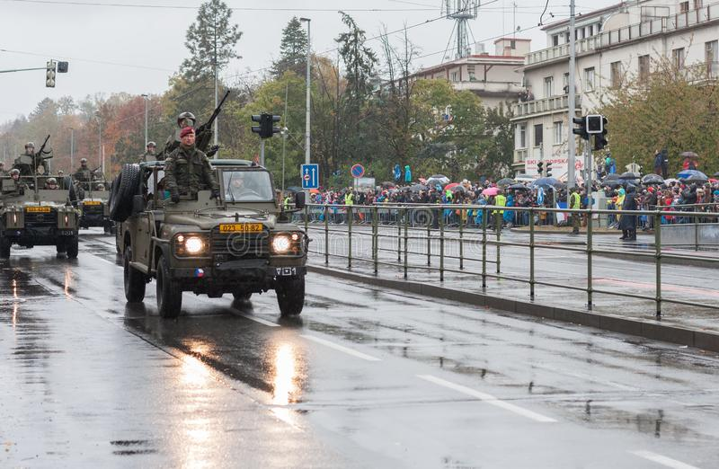 Soldiers of Czech Army are riding Land Rover Defender cars on military parade. European street, Prague-October 28, 2018: Soldiers of Czech Army are riding Land royalty free stock image