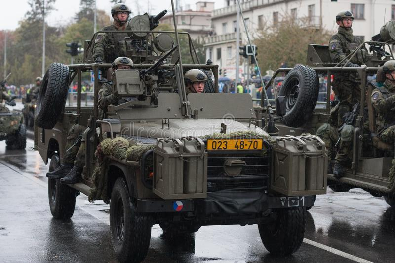 Soldiers of Czech Army are riding Land Rover Defender cars on military parade. European street, Prague-October 28, 2018: Soldiers of Czech Army are riding Land stock images