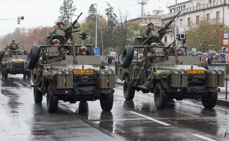 Soldiers of Czech Army are riding Land Rover Defender cars on military parade. European street, Prague-October 28, 2018: Soldiers of Czech Army are riding Land stock photography
