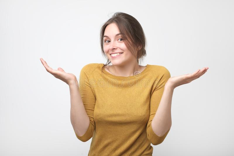 European student woman in gesture of asking over gray background stock images