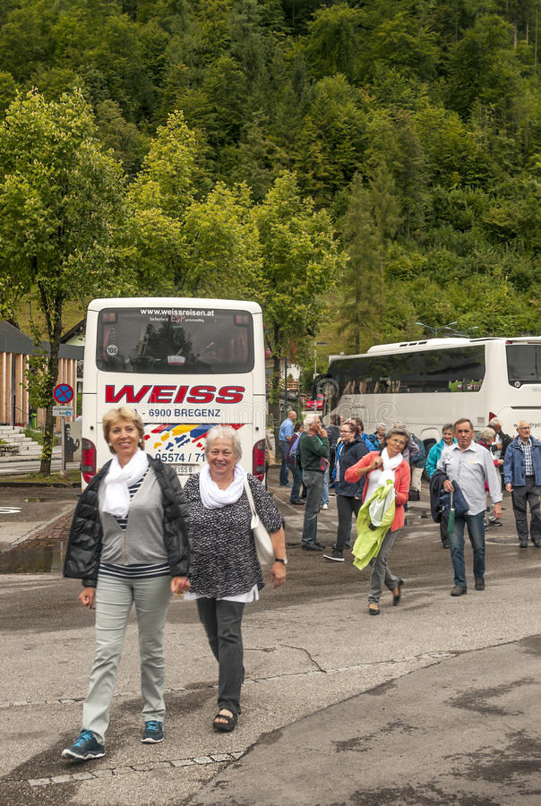 European tourists getting off the bus royalty free stock photo