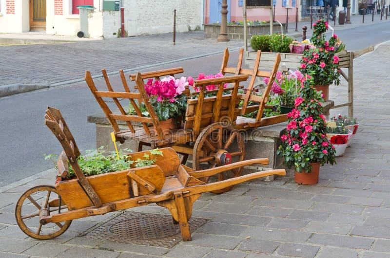 European town street with wooden flower pot royalty free stock photos