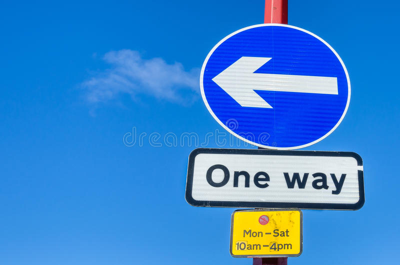 European Traffic Signs against Blue Sky. One Way Traffic Signs Against Blue Sky stock photography