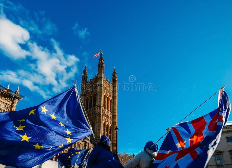 European Union and British Union Jack flag flying in front of Houses of Parliament at Westminster Palace, London. Brexit EU referendum theme royalty free stock image