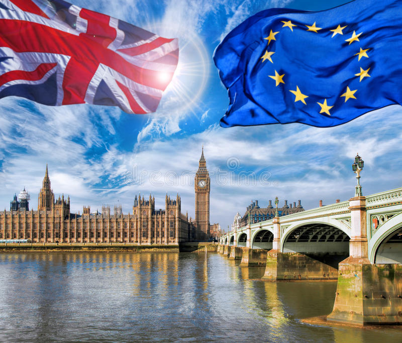 European Union and British Union flag flying against Big Ben in London, England, UK, Stay or leave, Brexit. European Union and British Union flag flying against stock photos
