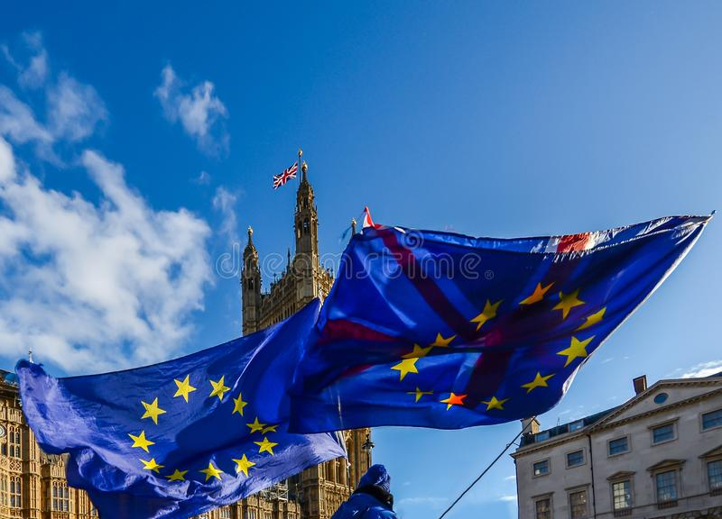 European Union and British Union Jack flag flying in front of Houses of Parliament at Westminster Palace, London. In protest to the 2016 decision to leave the stock image