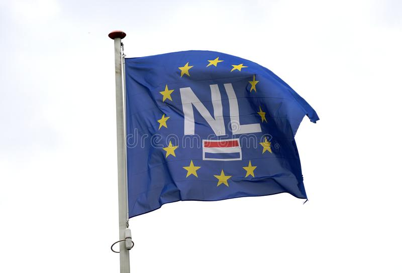 European Union and Dutch flag. Blue European Union EU flag with the Dutch flag and abbreviation of the Netherlands NL in its center stock images