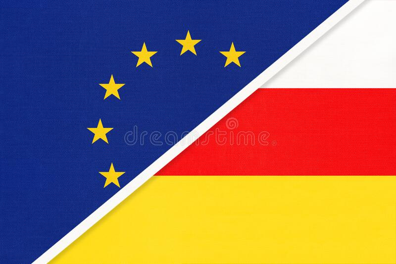 European Union or EU and South Ossetia national flag from textile. Symbol of the Council of Europe association. European Union or EU and Republic of South royalty free stock image