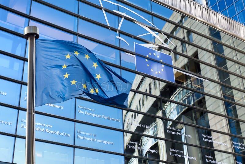 European Union flag against European Parliament. European Union flags in front of the European Parliament in Brussels, Belgium royalty free stock image