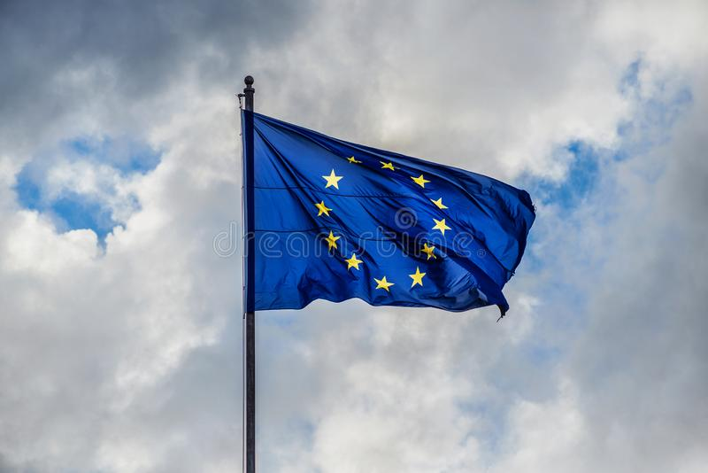 European Union Flag with clouds royalty free stock photos