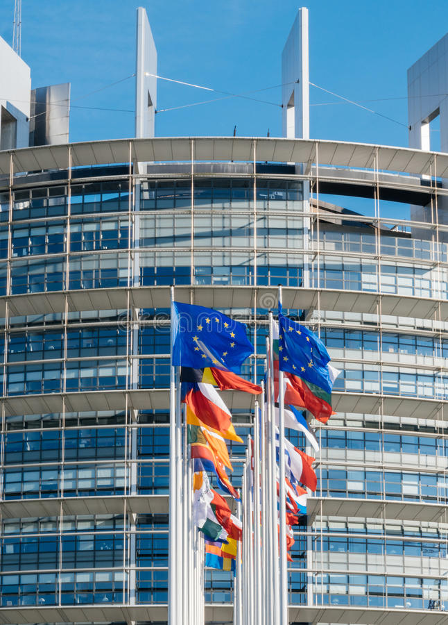 European Union Flag fly at half mast after Manchester terrorist. Front view of European Union flag fly half-mast European Parliament building memory of victims royalty free stock images