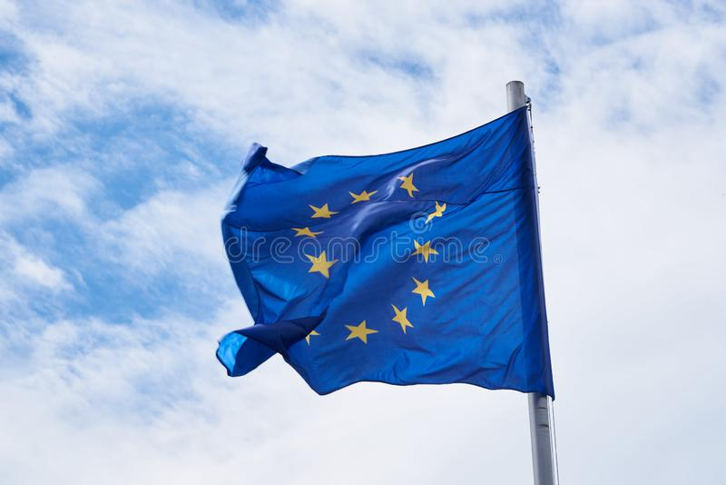 European Union flag with sky in the background horizontal. European Union flag with sky in the background - horizontal royalty free stock images