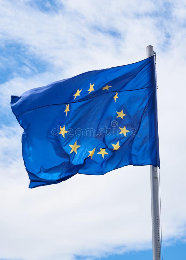 European Union flag with sky in the background vertical. European Union flag with sky in the background - vertical stock photography