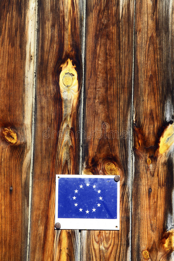European Union flag. Vertical shot of the European Union flag on some wooden planks royalty free stock images