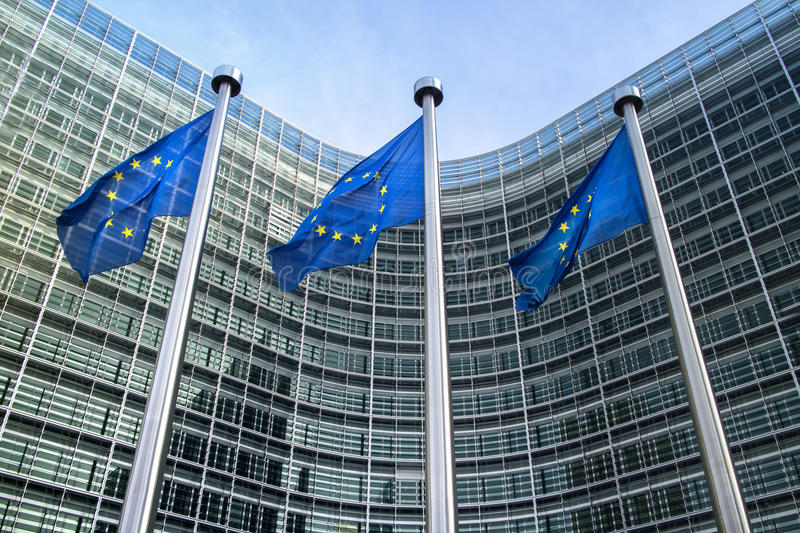 European Union flags near European commission. European Union flags in front of the Berlaymont building (European commission) in Brussels, Belgium stock images
