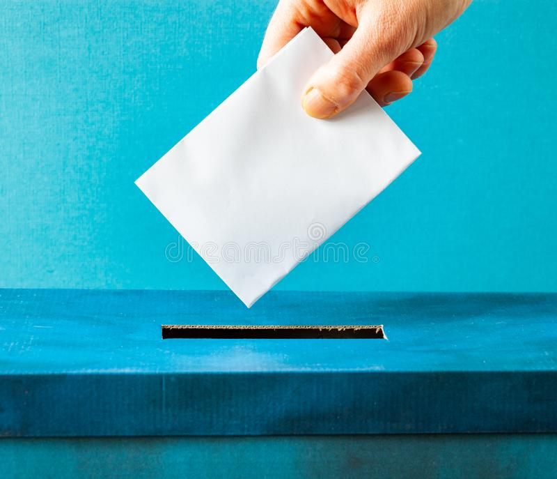 European Union parliament election concept - hand putting ballot in blue election box. Politics, referendum, vote, democracy, voting, government, background stock photos