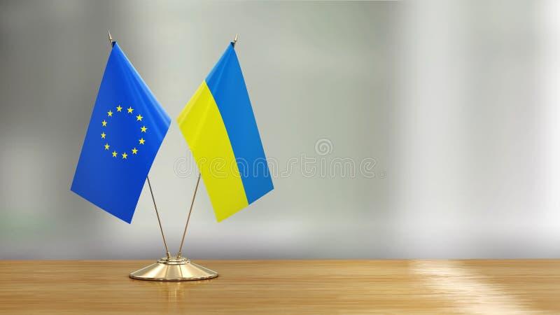European Union and Ukrainian flag pair on a desk over defocused background. 3d Image of European Union and Ukrainian flag pair on a desk over defocused vector illustration