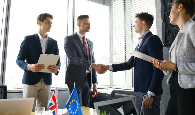 European Union and United Kingdom leaders shaking hands on a deal agreement. Brexit. European Union and United Kingdom leaders shaking hands on a deal agreement stock image