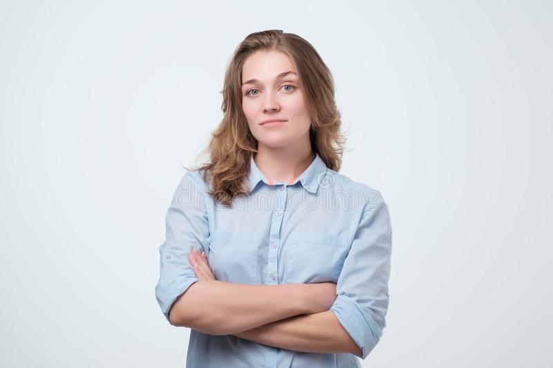 European woman in blue shirt with serious facial expression. royalty free stock image