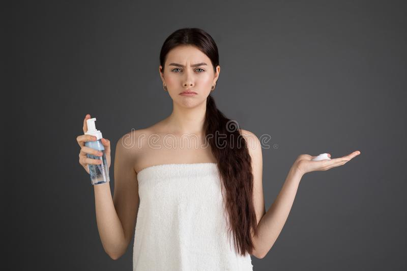 European young sad woman with perfect skin in bath towel royalty free stock image