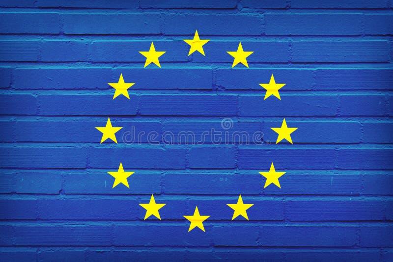 Europeisk facklig flagga som m?las p? tegelstenv?ggen v?gg f?r textur f?r bakgrundstegelsten gammal stock illustrationer