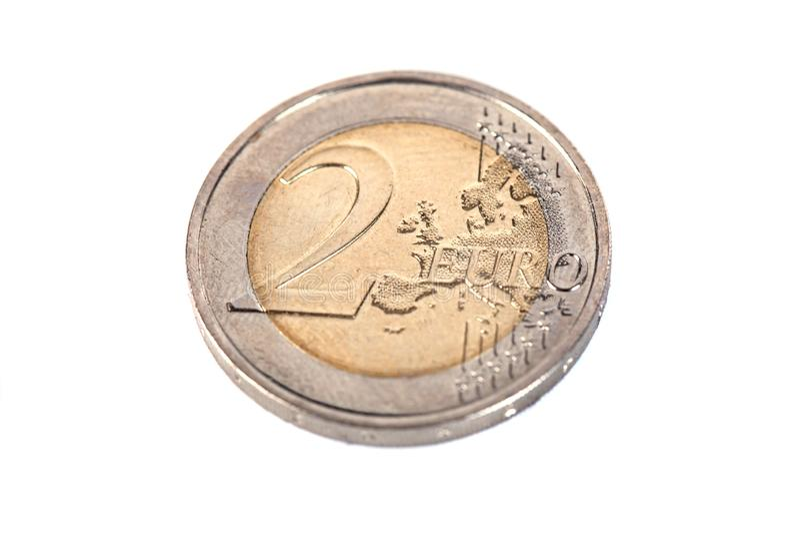 Europejczyk moneta Dwa euro, odizolowywająca na białym tle zdjęcie stock