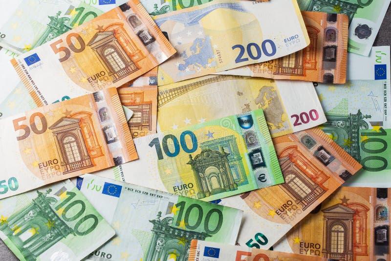 Europengar kontantbakgrund i euro eurosedlar Plats med eurosedlar i pappersform som en del av det enade landets\ betalning royaltyfri fotografi