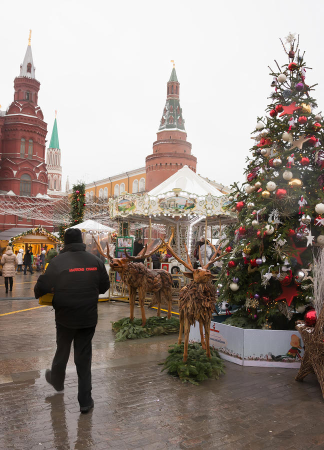 Europian Christmass Market in fron of the Red Square. With Kremlin towers at the background stock photo