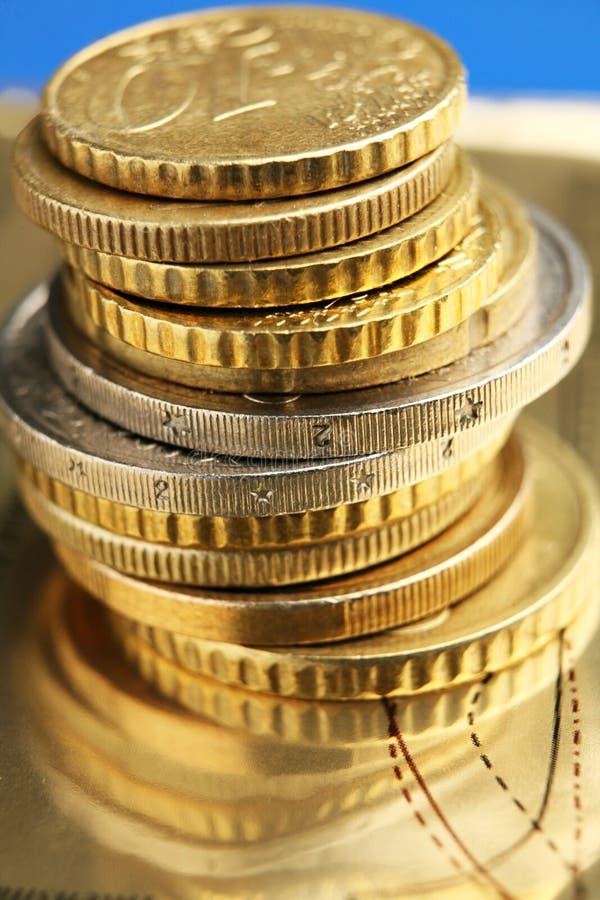 Euros. Pile of euro coins on golden background stock photo