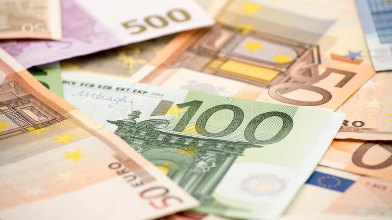 Euros bills of different values. Euro bill of one hundred royalty free stock photos