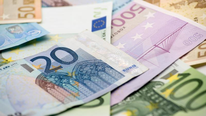 Euros bills of different values. Euro bill of twenty over others bills royalty free stock photography