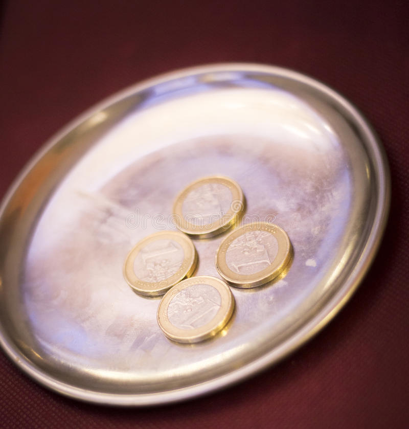 Euros coins change money. In restaurant on metal tray paying meal check royalty free stock photography