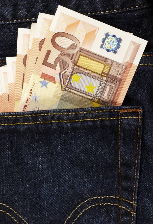 Euros en bolsillo posterior fotografía de archivo