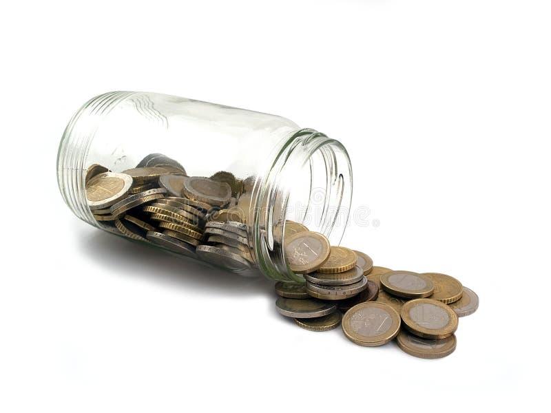 Euros en un tarro de cristal imagen de archivo libre de regalías