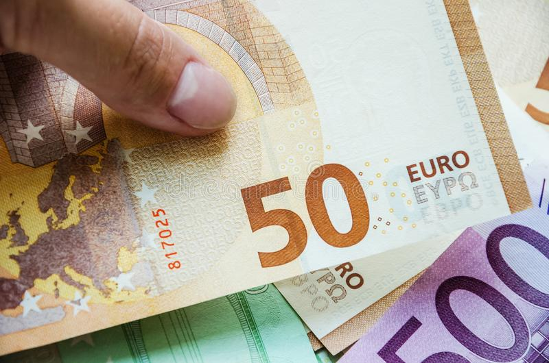 50 euros and a finger, close-up royalty free stock photography