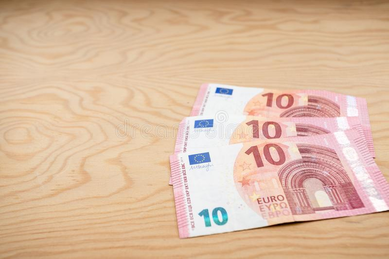 10 Euros notes fanned out on a light wood background royalty free stock photo