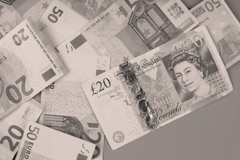 Euros and Pounds background stock photo