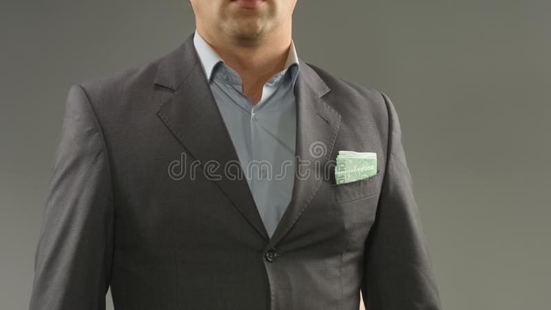Euros in rich male suit pocket, money saving, income and successful startup. Stock photo royalty free stock photography