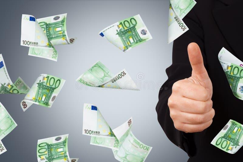 Eurosedlar med bekräftelsetecknet av affärskvinnan royaltyfri foto