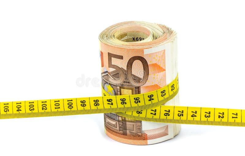 Eurosedlar med måttbandet på vit bakgrund royaltyfri foto