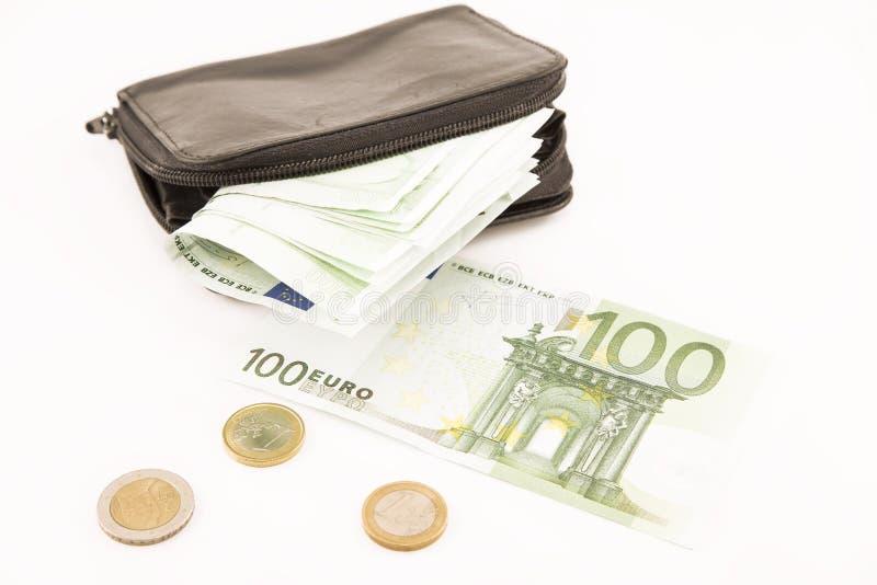 Eurosedlar och en svart pl?nbok fotografering för bildbyråer
