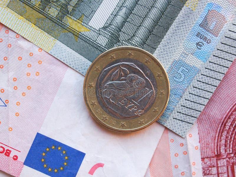 Eurosedlar och ett 1 euromynt från Grekland arkivfoton